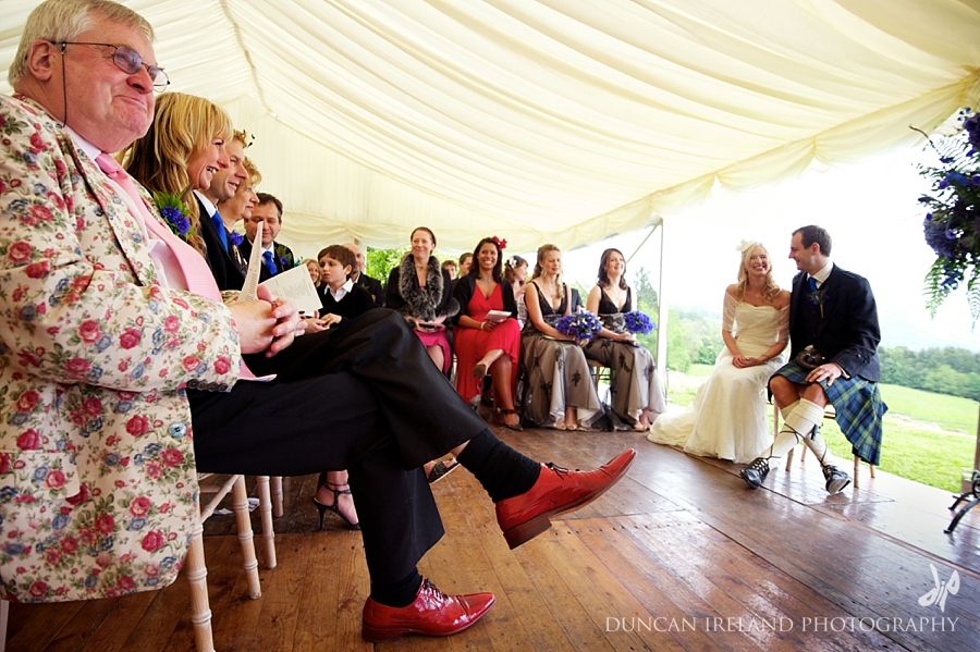 Unusual wedding outfit red shoes