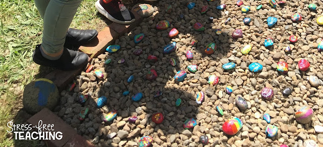 Shadows of students looking at the Kindness Rock Garden