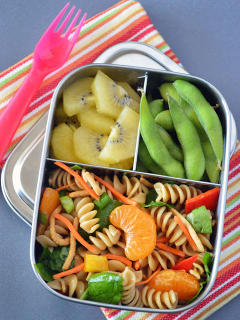 This Chinese Mandarin Pasta Salad is packed with mini sweet peppers, mandarins, green onions, spinach and carrots, then tossed with a sesame ginger dressing and topped with Chow Mein noodles for added crunch.