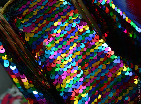 close up rainbow sequins side gusset of handbag