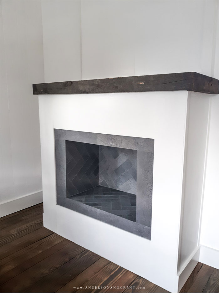 White fireplace with gray tile insert