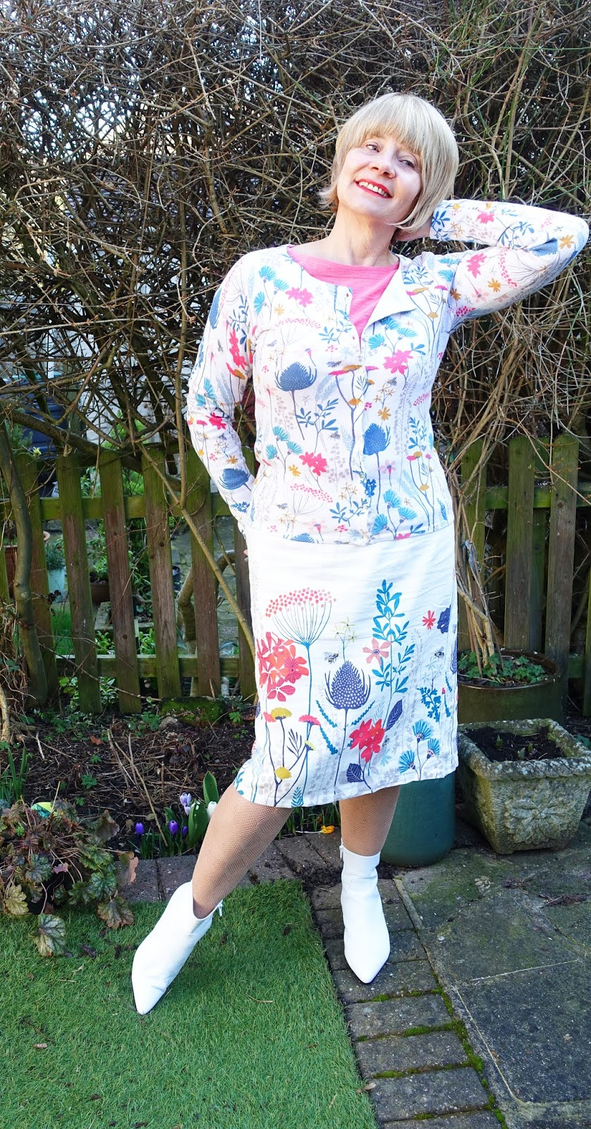 A gorgeous floral print, Floral Meadow, adorns this Kemble cardigan and Border Print skirt by Lily and Me