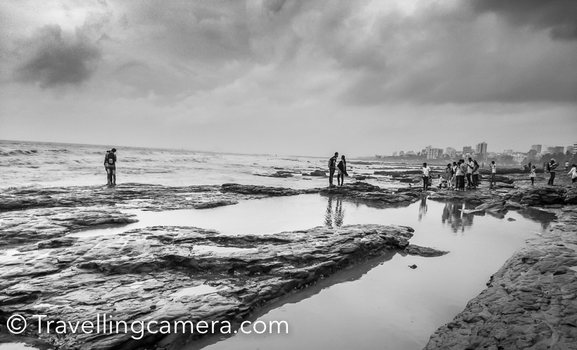 If you have been following my series of Photo Journeys by Huawei P9 , you must have noticed the potential of it's dual cameras. I am loving this camera and would be sharing various Photo Journeys clicked through it's dual lenses powered by Leica . This Photo Journey shares some of the mobile clicks from Mumbai. It was a short trip to Mumbai . I wanted to spend more time in streets but monsoons didn't allow me to do so. I could hardly walk around the city. We had booked a cab and went to various place. The taxi was our shelter during rain and rest of the time was spent around Bandstand, Sea Link , Gateway of India , Haji Ali  and Marine Drive.Huawei P9 is a good phone to carry while travelling and I enjoyed clicking nature shots  with it. Few days back I also curated a post explaining about various camera features  of P9 and best ways to use them. Personally I loved clicking Time-Lapse videos Above is a panoramic shot clicked with mobile phone and it was pretty simple. Camera guides you to move camera and the speed to follow.Another shot of Bandstand. These rocks on seashore were extremely slippery. One has to be very careful when walking around this part of the sea-shore.After Bandstand we walked towards Taj Land's End and then Bandra fort from where you can capture Sea Link. Above is panoramic view from Castella de Aguada.Huawei P9 is also considered good for Monochrome photography but I am yet to explore it well. Hopefully I would be sharing a Black & White Photo Journey clicked through it's dual camera.We spent significant time around Castella de Aguada. It certainly offers great views of ocean and Sea Link.Some were busy looking at the sea, few were getting ready to get clicked and others were wondering what to do next...As we landed Juhu, it was the most disappointing experience of Mumbai. It was very dirty. This man was just setting up his stall for the evening, but rain was making his job very challenging.There were more crows than humans around the beach. We hardly spent 10 minutes at this place and came back to our hotel.Mumbai treated us well and Huawei P9 was a good companion to capture these memories for future. Stay tuned for more through this camera. And do follow our social media channels to get continuous updates.