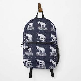 Unicorn backpack, featuring white unicorns in a pattern on a navy blue background.