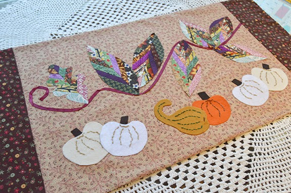 http://www.robinphillipsstudio.com/store/product/thanksgiving-pumpkin-table-mat/