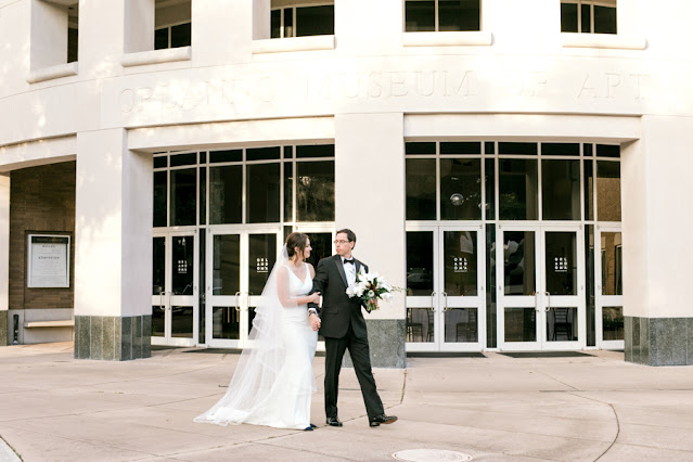bride and groom walking in front of orlando museum or art