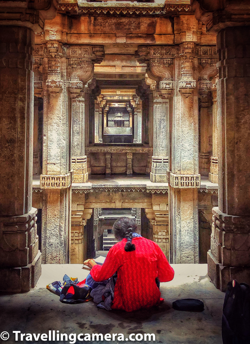 There is no entry ticket for Dada Harir Vav in Ahmedabad and it's maintained by Archeological Survey of India. The day we visited Dada Harir Vav, a group of art students were there at different levels of the stepwell noticing beautiful architecture of the stepwell and drawing it on their canvases. Above photograph shows one of the artists capturing beauty of Dada Harir Vav in her notebook. The red adds beautiful contrast to overall photograph.