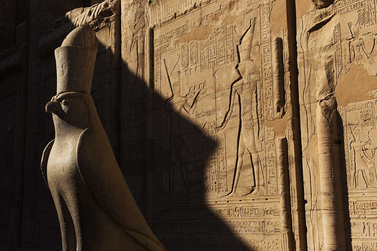 A stone sculpture of the falcon-headed god, Horus, located at the Temple of Edfu in Egypt.