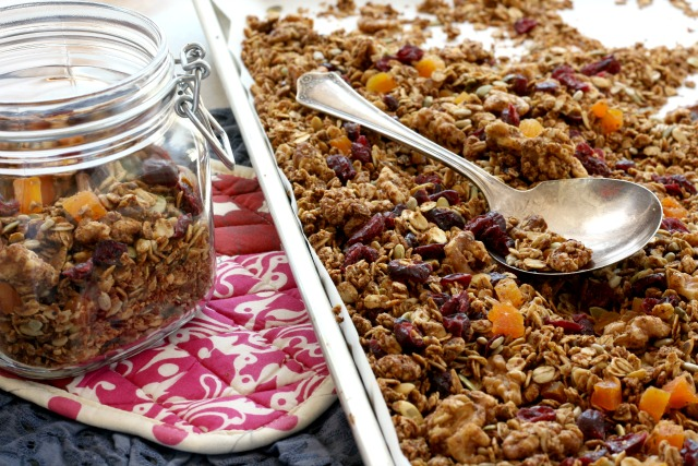 Super Healthy Granola for Everyday Snacking; includes nuts, seeds, coconut, dried fruit and old fashioned rolled oats. Naturally sweetened with molasses and maple syrup. Very little added fat.