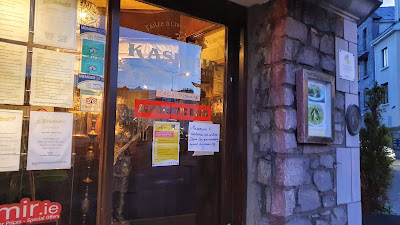 Front door of Kashmir Indian restaurant in Galway, Ireland just after the Covid-19 restrictions - takeaway only