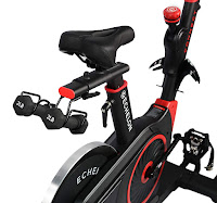 Echelon Smart Connect EX3 Spin Bike's competition saddle with dumbbell holder mounted on seat-slide, image