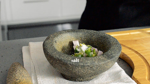 pestle and mortar to roughly pound shallots and chilli for guac