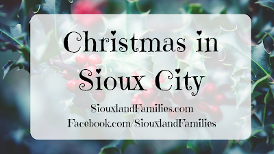 "in the background, green holly leaves and red holly berries are visible. in foreground, the words ""Christmas in Sioux City"""
