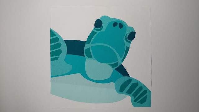 Sea turtle quilt block made using applique
