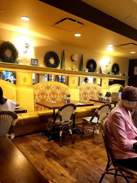 mirror green wreath Yellow Vase Cafe South Coast Plaza Orange County California flowers sunflowers French restaurant