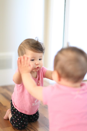 NAMC montessori infant toddler environment preparing for movement touching a mirror