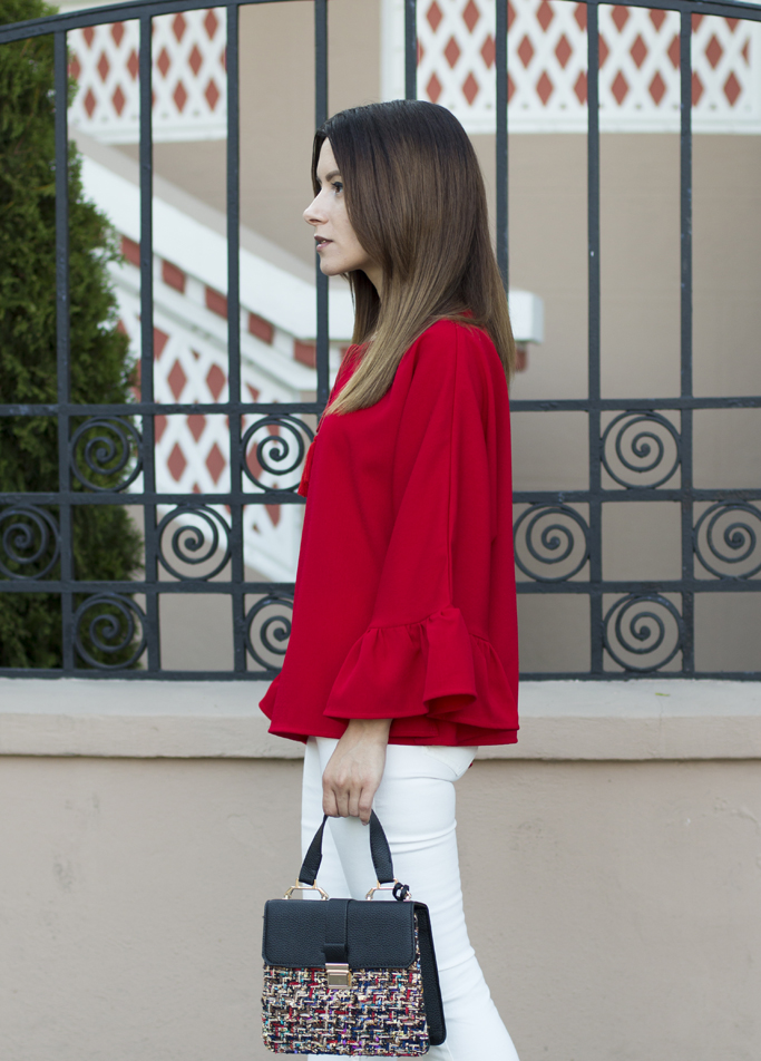 red blouse with ruffled sleeves