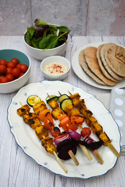 Grilled Rainbow Tandoori Tofu Skewers on a white platter