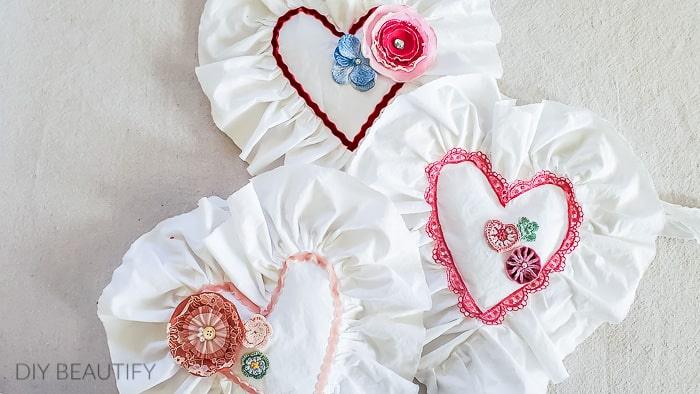 fabric hearts embellished with vintage trims