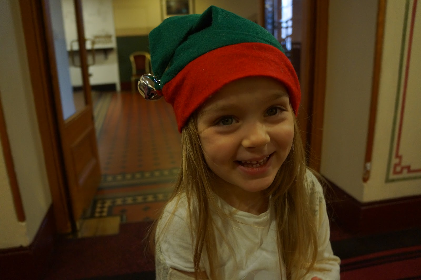 little girl in an elf hat