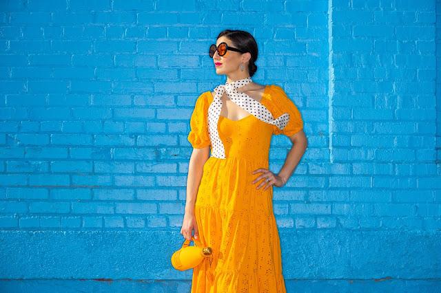 Meryl Franzos orange dress and blue bricks