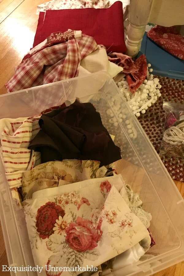 Messy pile of fabric scraps in a plastic bin