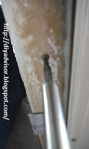 This is the middle inside door frame screw being tightened
