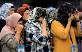 Image result for Muslim women lend Christians their hijabs to help them escape Isis in disguise