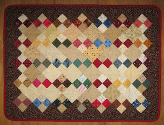 Four-patch doll quilt