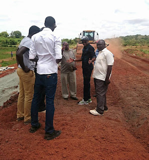 Ababu Namwamba with contractor survey a road launched by President Kenyatta in Budalang'i. PHOTO | Courtesy