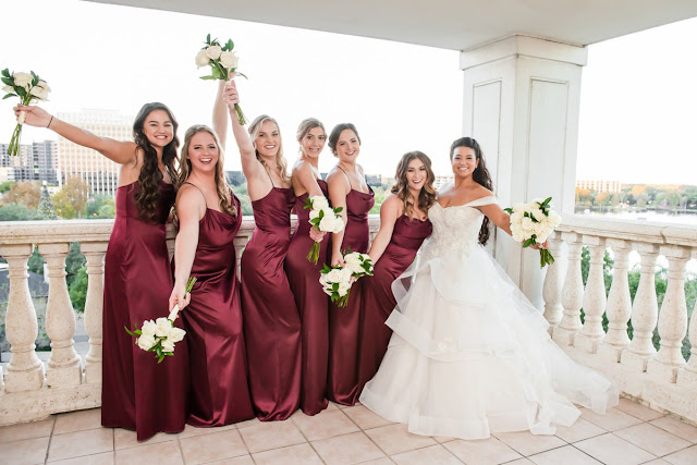 bride and bridesmaids in burgundy