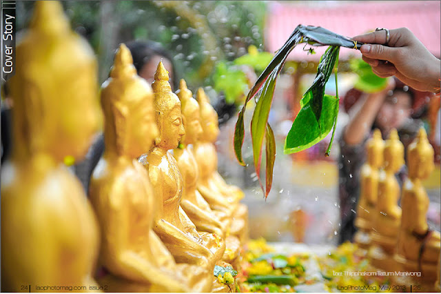 Lao New Year - Blessing the Buddha Statues ສົງພຣະ