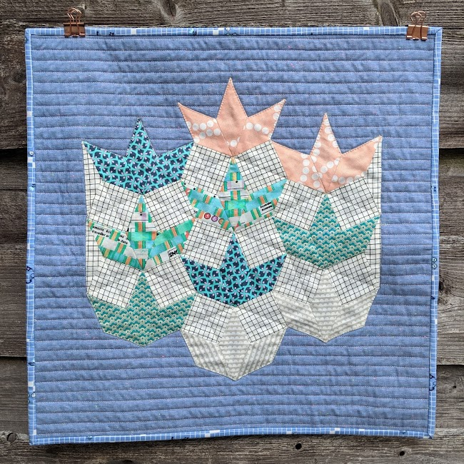 the seedlings modern epp applique quilt