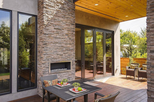 Table and outdoor fireplace in the Contemporary Style Home in Burlingame