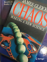 Chaos: Making a New Science, by James Gleick, superimposed on Intermediate Physics for Medicine and Biology.
