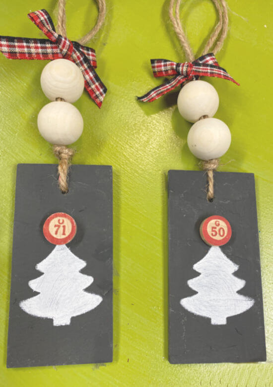Two stenciled tree ornaments