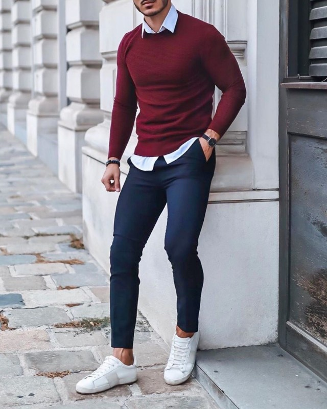 Maroon sweater with blue trousers, men.