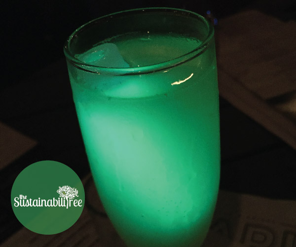 A glow stick is added to a drink to make it more exciting during Earth Hour