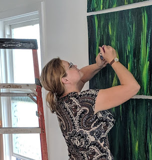 Artist Irina Sztukowski works on Green Abstract Artwork for Portland Cafe