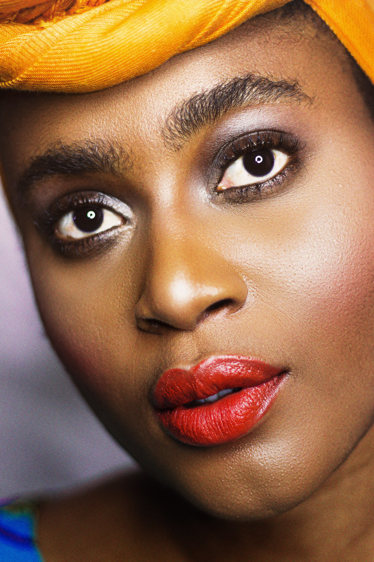 African woman with red YSL lipstick looking up