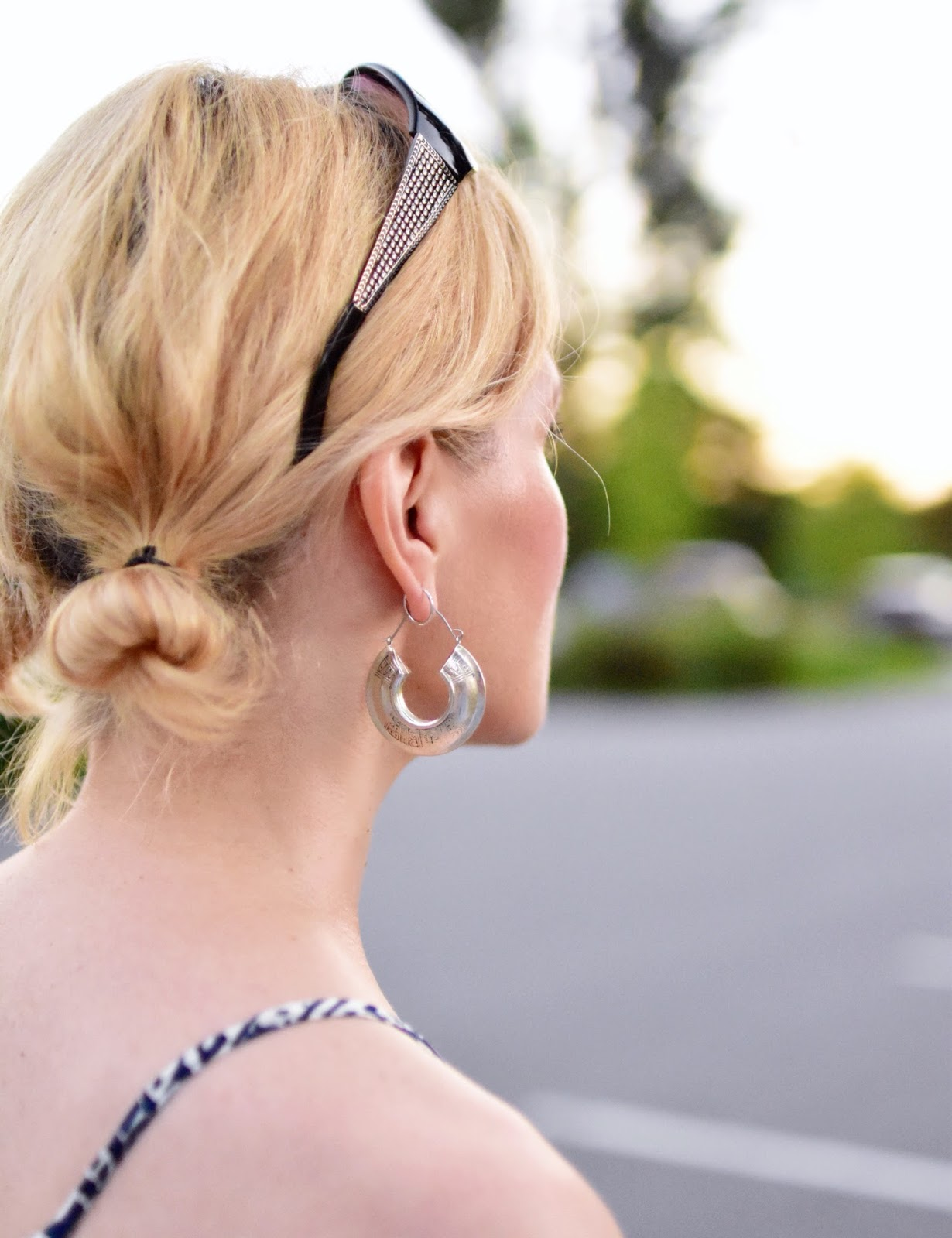 sunglasses, hoop earring, double bun hairstyle