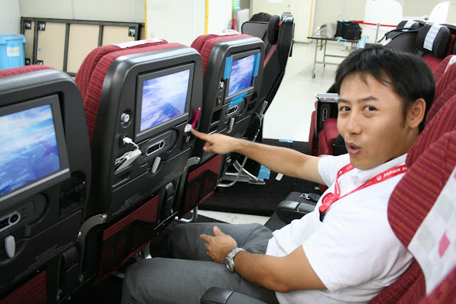 Staff from JAL cabin product design department tried out the new SKY WIDER seat