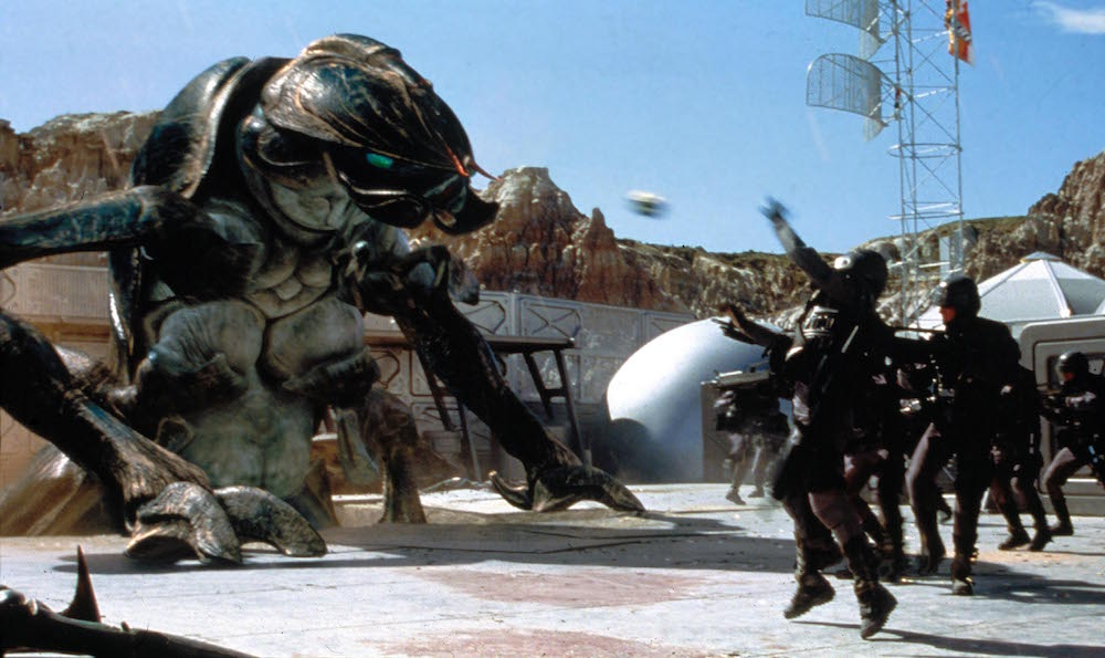 giant alien coming out of the ground and soldiers shooting for blog post about guilty pleasure war movies