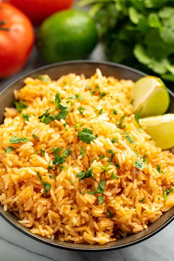 This Authentic Mexican Rice is super easy to make and goes perfectly with any Mexican meal! #authenticmexicanrice #mexicanrice #rice