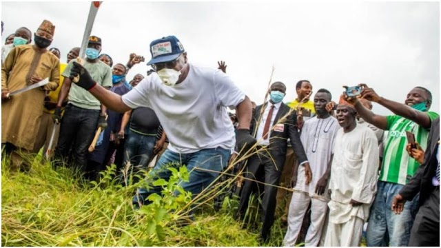 Kwara state governor pictured cutting school grass ahead resumption