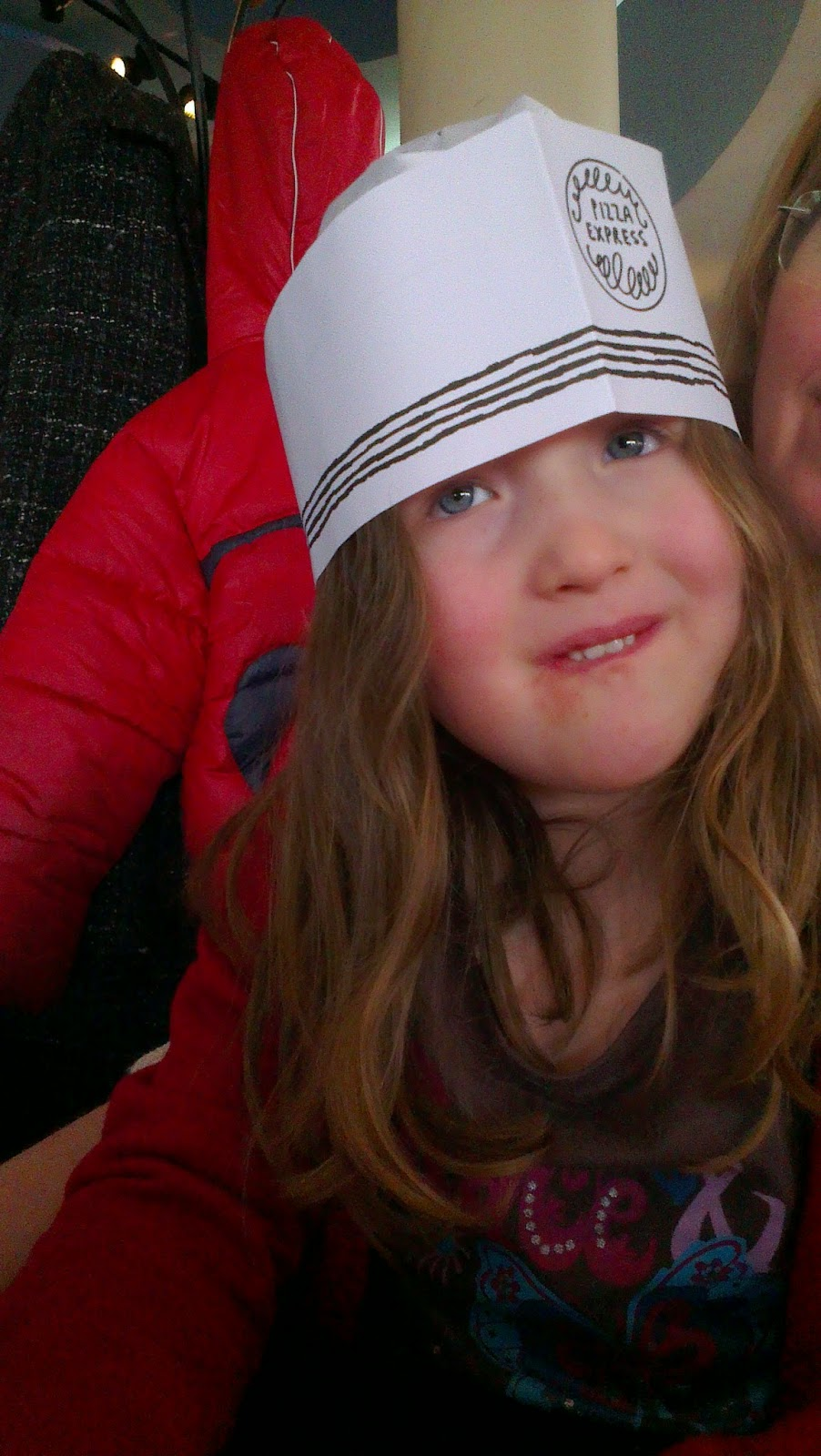 Caitlin wearing a Pizza Express paper hat