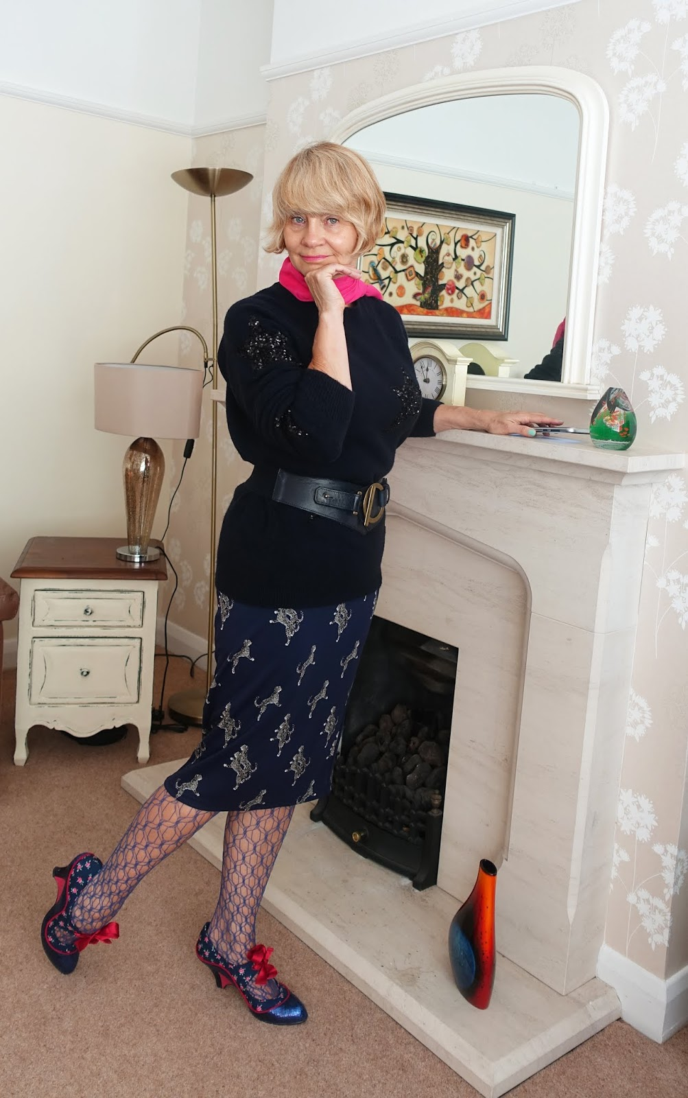 Over 40s blogger Gail Hanlon in winter attire in July, to show that you can find timeless bargains from previous seasons in the July sales. Here she is wearing a sequinned star jumper and Jaycee skirt from The-Bias-Cut.com