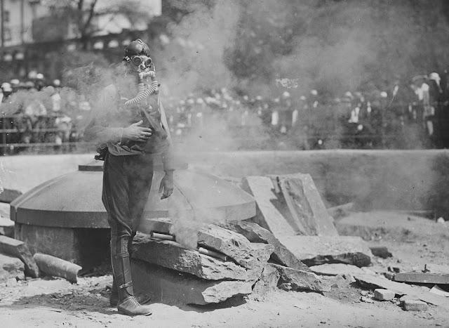 Original caption: A Boy Scout testing a gas mask in Union Square, New York City.
