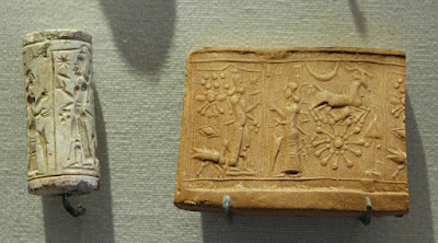 A Mesopotamian limestone cylinder-seal, and a seal impression made on clay by rolling the seal