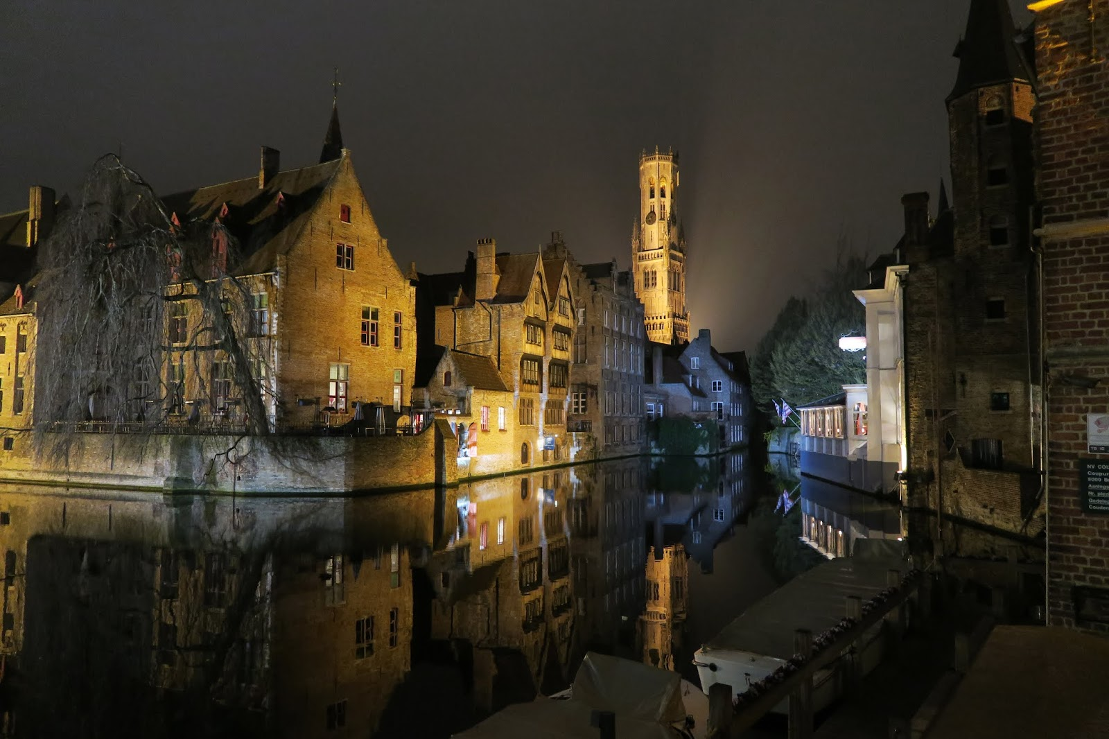 Bruges main canal at night with Bruges Belfry and other buildings lit up